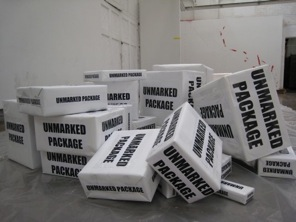 A pile of packages marked UNMARKED PACKAGE
